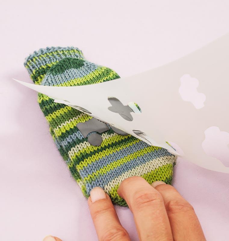 Sockenbremse auftragen - Schablone abziehen