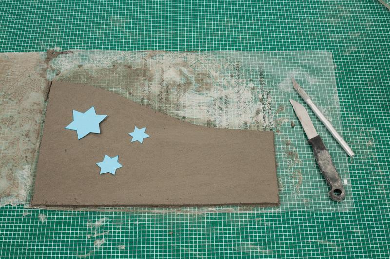 Windlicht aus Knetbeton - Sterne auflegen